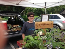 Grant helps us harvest and present the vegetables, herbs and flowers to our market customers.